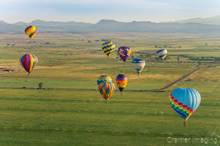 Cramer Imaging's fine art aerial photograph of a hot air balloon cluster floating over a field in Panguitch Utah