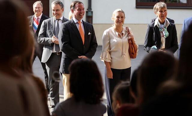 Princess Stephanie wore a ruffle sleeve blouse from Paule Ka. Hereditary Grand Duke Guillaume and Hereditary Grand Duchess Stephanie