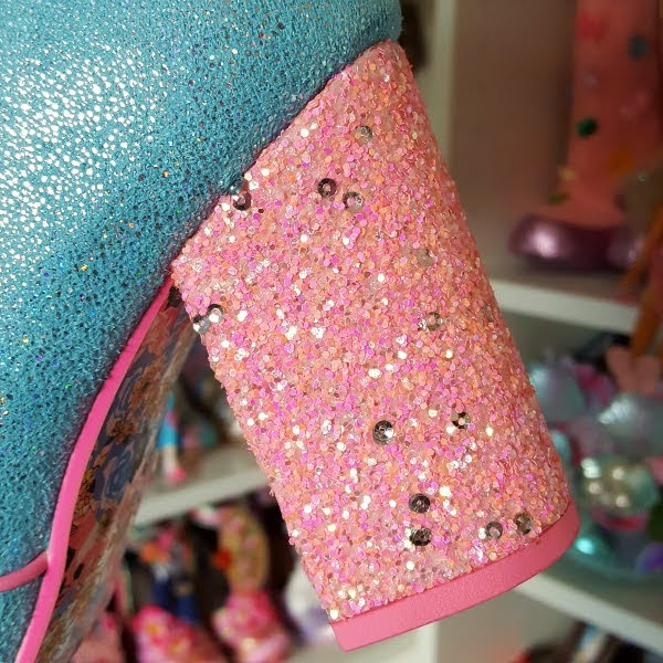 pink glitter block heel of boot