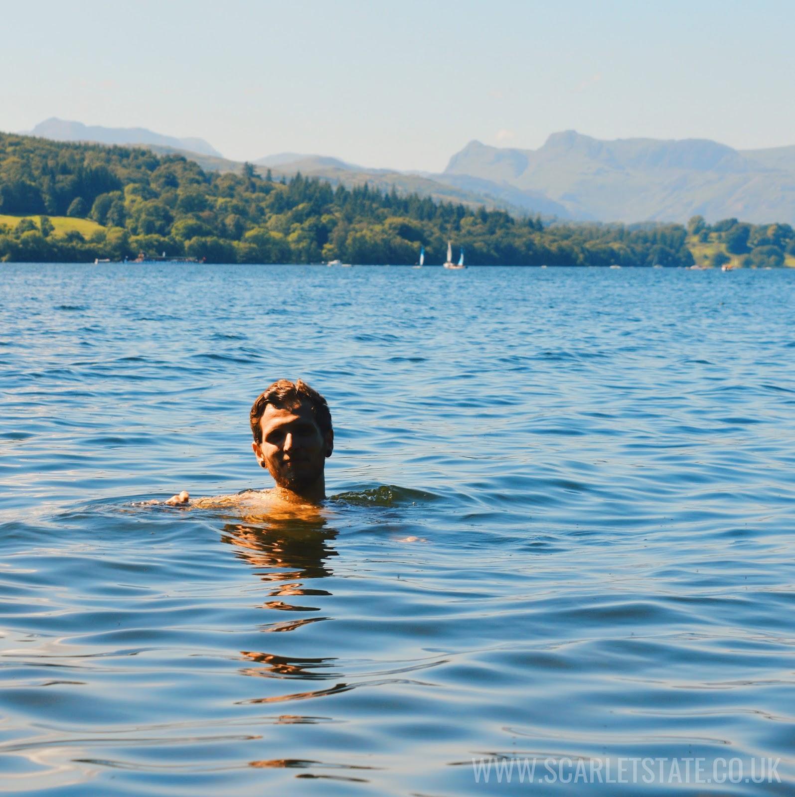 Man swimming in lake