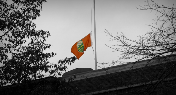 Lowering the flags to half-mast
