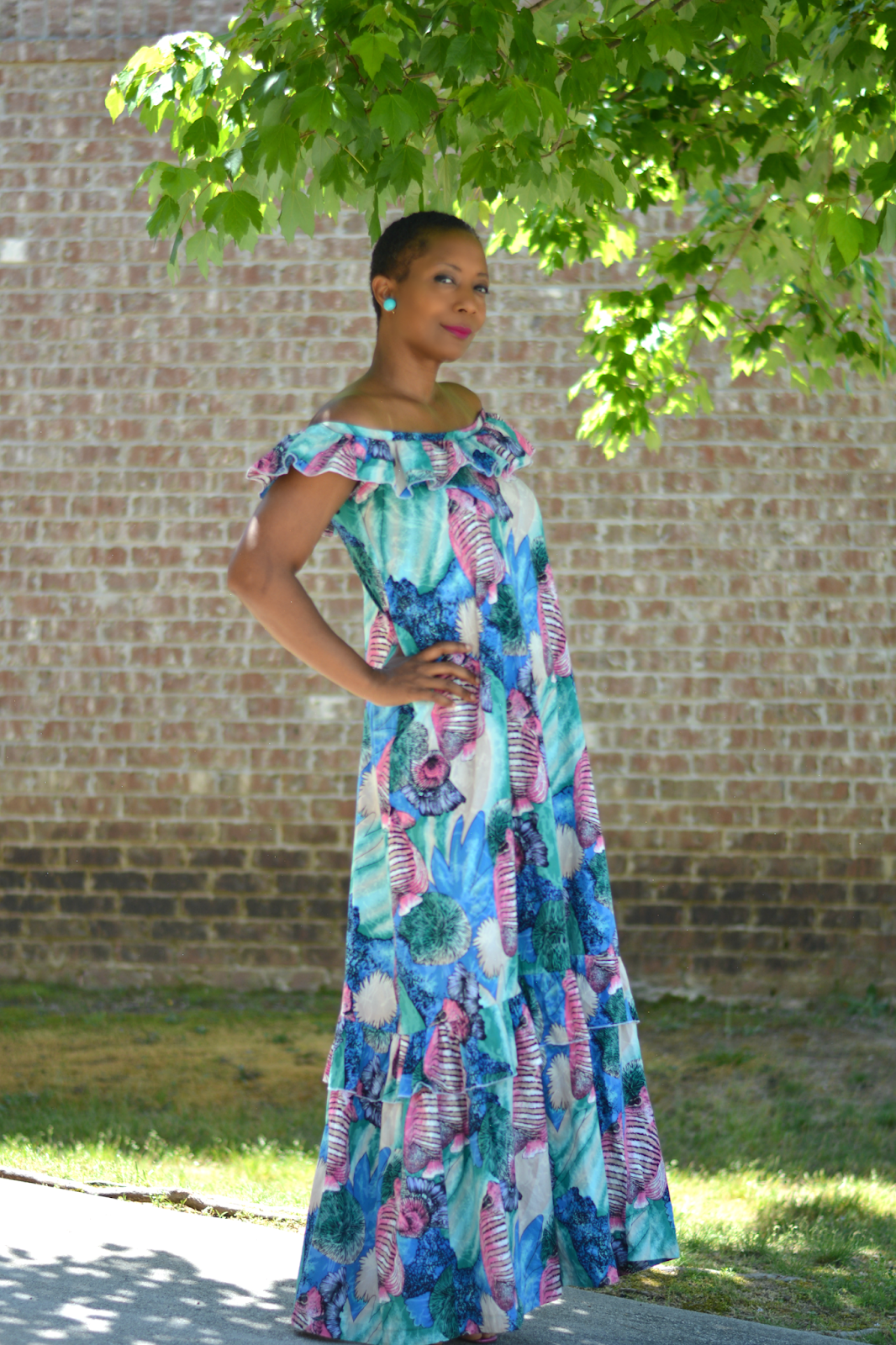 Refashion and downsizing of a vintage thrift store muumuu to a chic summer off the shoulder maxi dress.