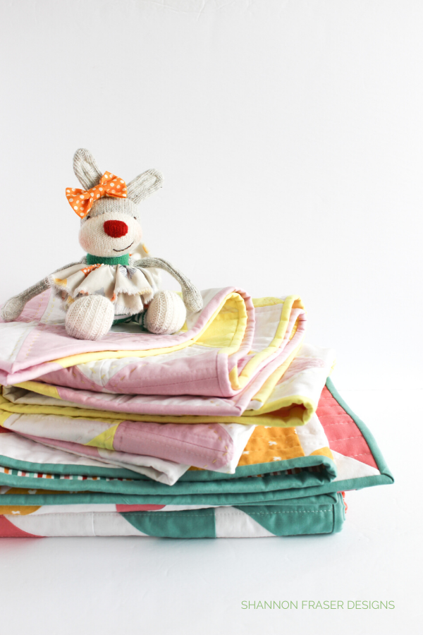 Louise the bunny on top of a stack of Pink Lemonade quilts | Why I create | Shannon Fraser Designs #quilts #modernquilts