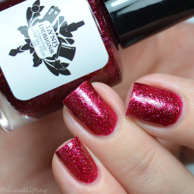 red nail polish with iridescent flakies