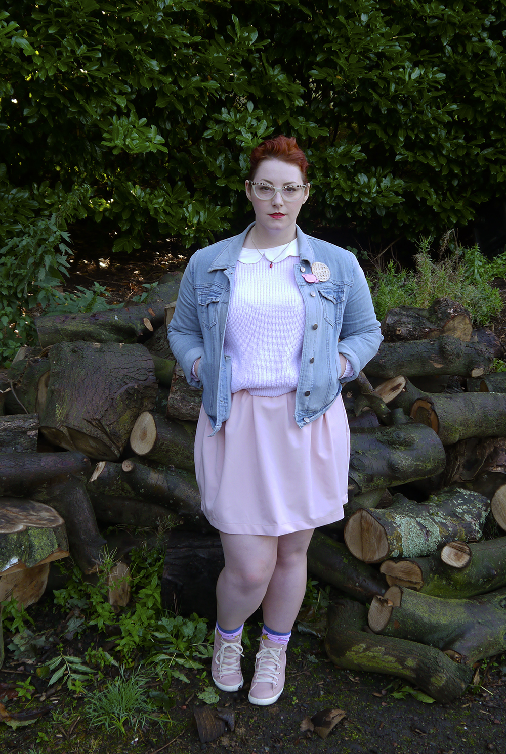 unlikely style icon, costume inspiration, Stranger Things, Eleven from Stranger Things, Stranger Things inspired outfit, Spex Pistols glasses, Cheap Frills christmas light necklace, denim jacket, pink outfit, Eat Me do socks , Wear Eponymous skirt, Eggo brooch, bonnie bling brooch, Lucky Dip club brooch