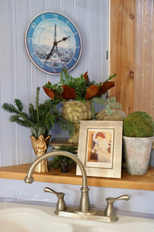 Evergreens and neutral colored Christmas decor transitions to Winter decor