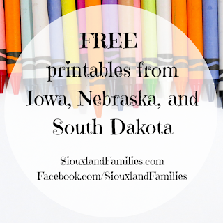 """in background, a row of fresh crayons against a light gray tabletop. in foreground, the words """"FREE printables from Iowa, Nebraska, and South Dakota"""""""