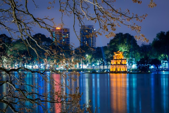 Hanoi is quiet under the lights when the sun is just off