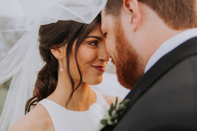 close up of brides face looking at groom
