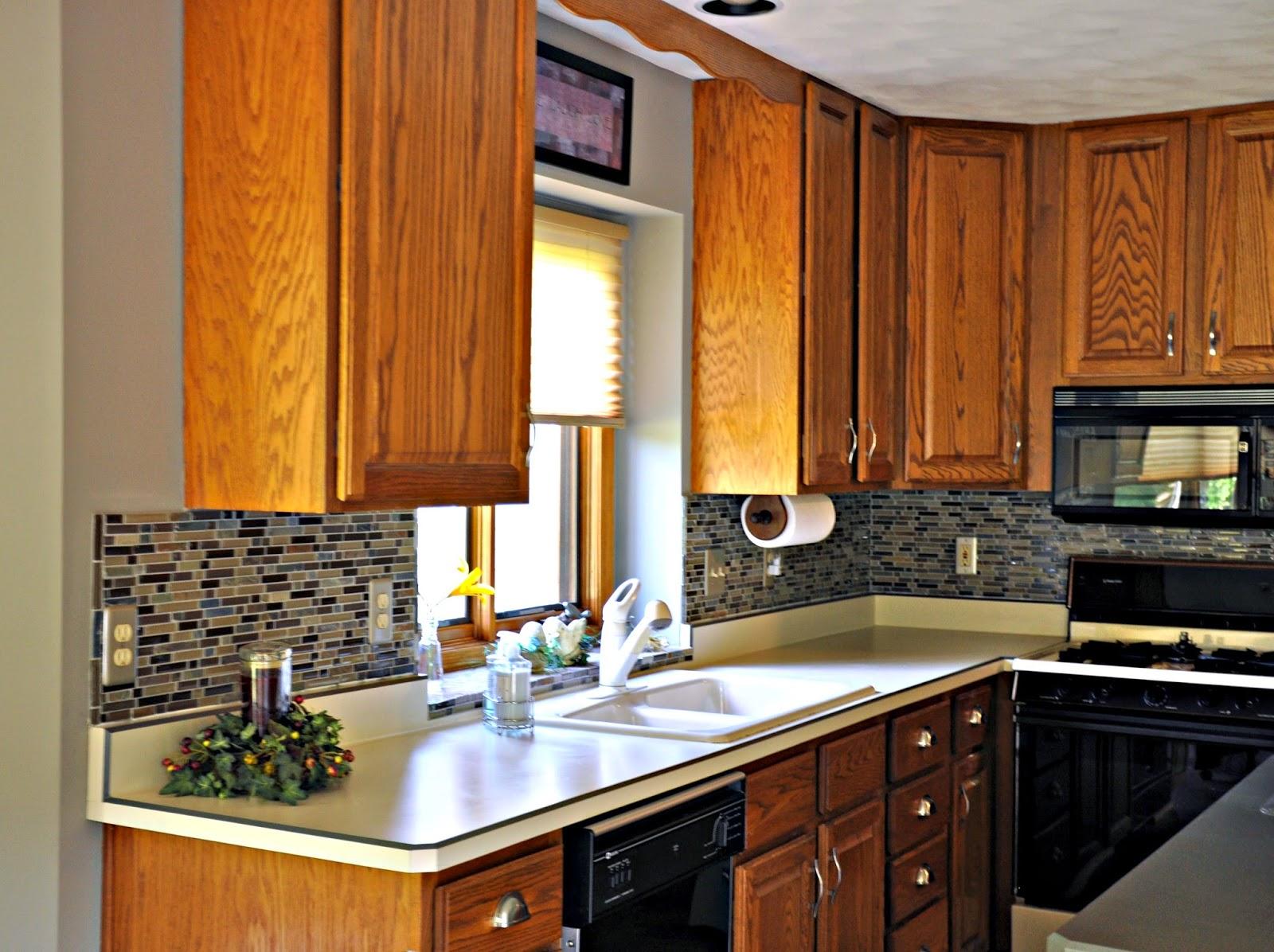 diy updates glass mosaic tile kitchen installing kitchen backsplash DIY Updates Glass Mosaic Tile Kitchen Backsplash and Marble Tile Fireplace Surround