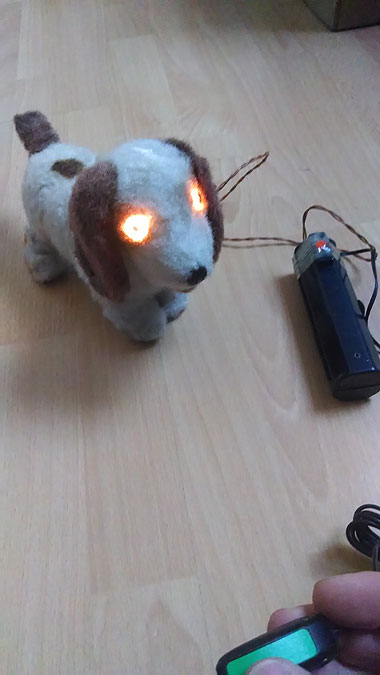 Switch adapted remote control dog with light up eyes.