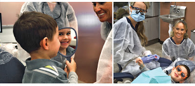 image of a young child looking in the mirror and working with dental students at a clinic