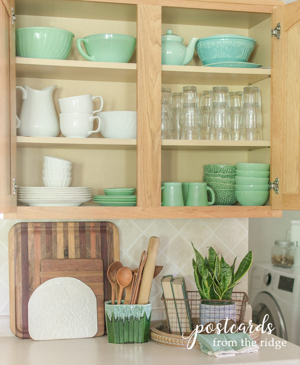 a vintage mccoy planter is repurposed as a kitchen utensil holder