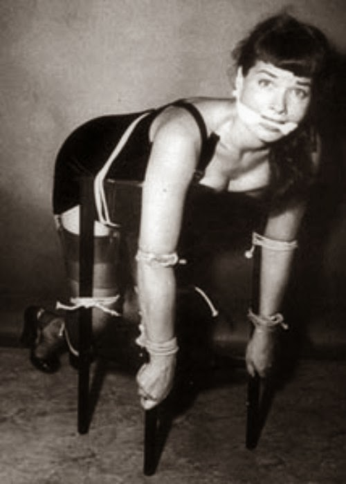 Bettie Paige bounded on a chair