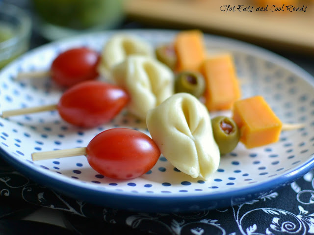 A light and delicious appetizer that's perfect for any Italian themed meal! The bold and tangy flavors are sure to satisfy any appetite! Mini Tortellini Kabobs with Lemon Basil Vinaigrette Recipe from Hot Eats and Cool Reads