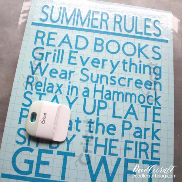 Place vinyl cut with Cricut Maker on wood board to make a Summer Rules Cricut Vinyl Wood Sign DIY