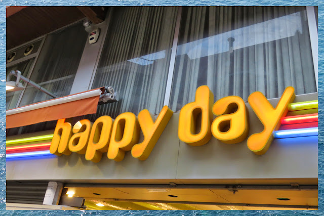Happy Day Neon Sign in Lloret de Mar, Costa Brava, Spain