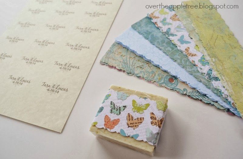 Use scrapbook paper to wrap and personalize DIY soap by Over The Apple Tree