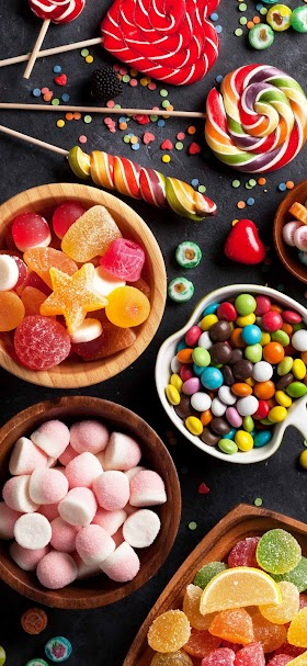 خلفية سكاكر وحلوى متنوعة الأشكال و الألوان