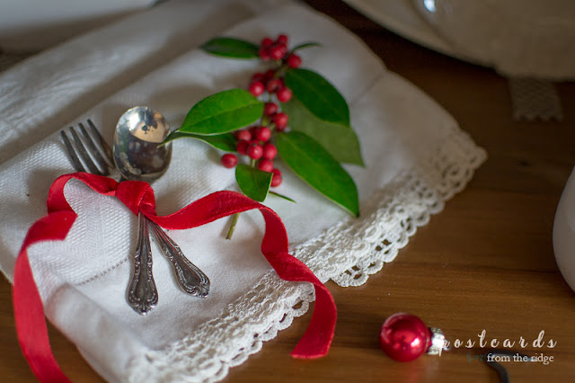 old baby silverware and red velvet ribbon