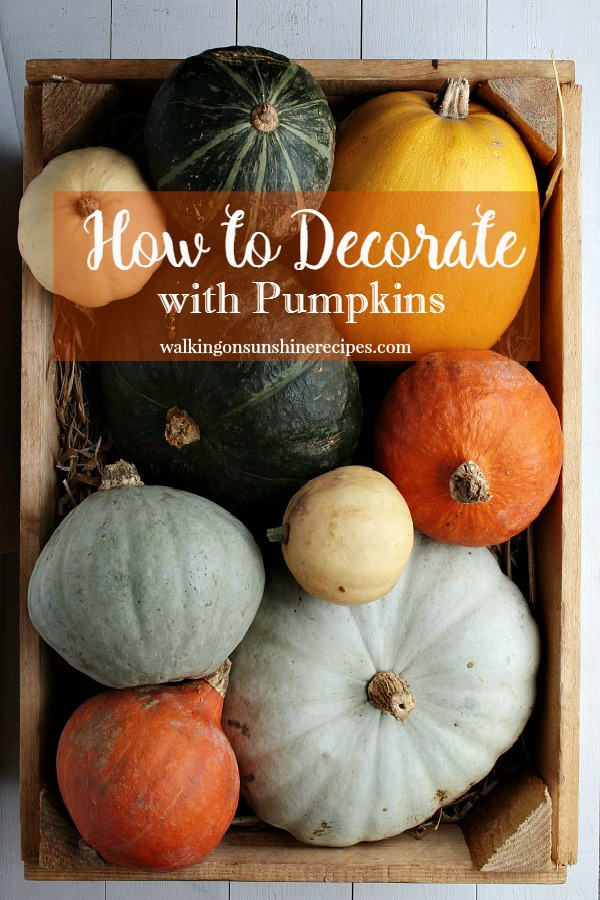 Multicolored pumpkins look beautiful in a wooden bowl featured on Walking on Sunshine.