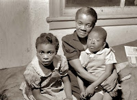 Mother and two children on welfare, Chicago, 1941