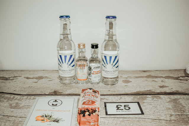 The contents of the December I Love Gin box lined up on table