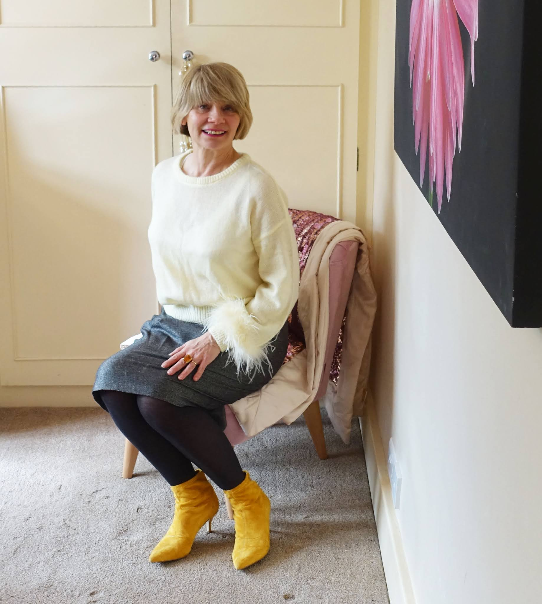 Blogger Gail Hanlon from Is This Mutton in her take on the Pantone Colors of the Year 2021 with a yellow maribou-trimmed jumper and grey skirt