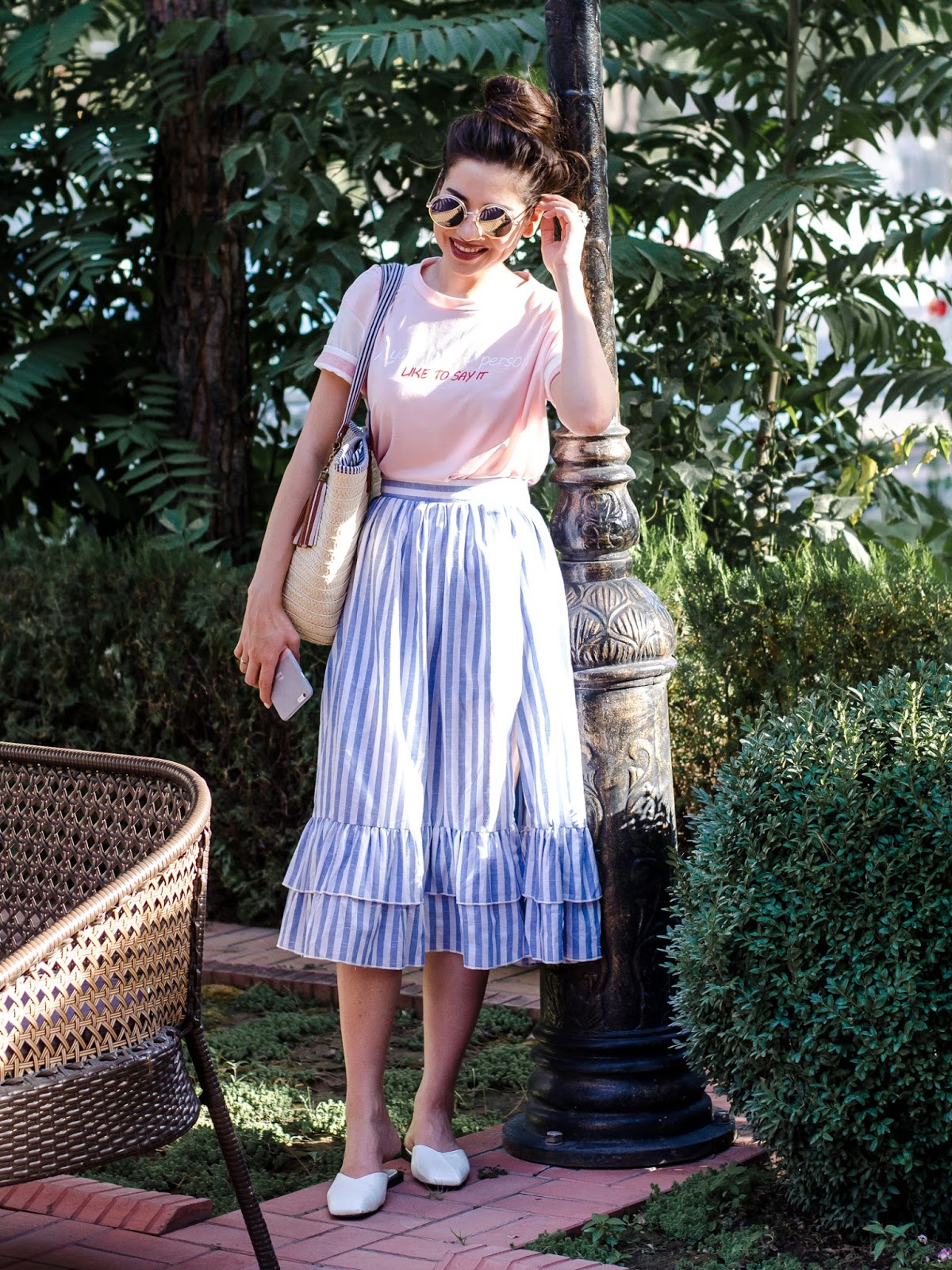 diyorasnotes diyora beta fashion blogger style outfitoftheday lookoftheday striped skirt short pink top straw bag mules casual street style 2017