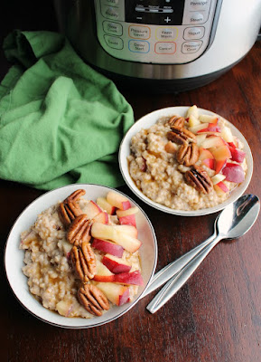 Bowls of maple cinnamon steel cut oatmeal with peaches and pecans in front of pressure cooker