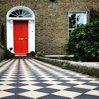 Photos of Dublin Doors: orange Georgian door with checkered tile