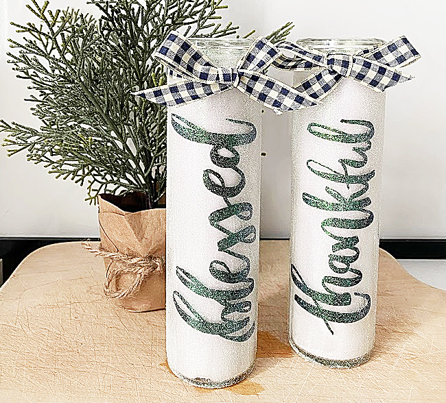 glittered candles with black and white checked bow