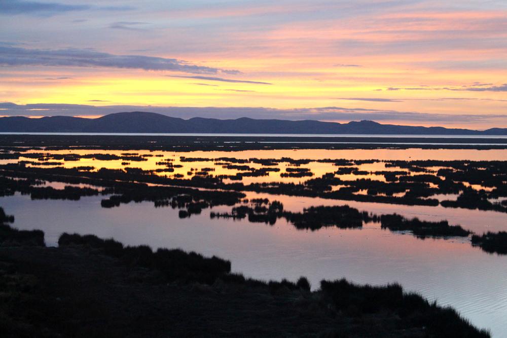 Lake Titicaca at sunrise, Puno, Peru - travel blog