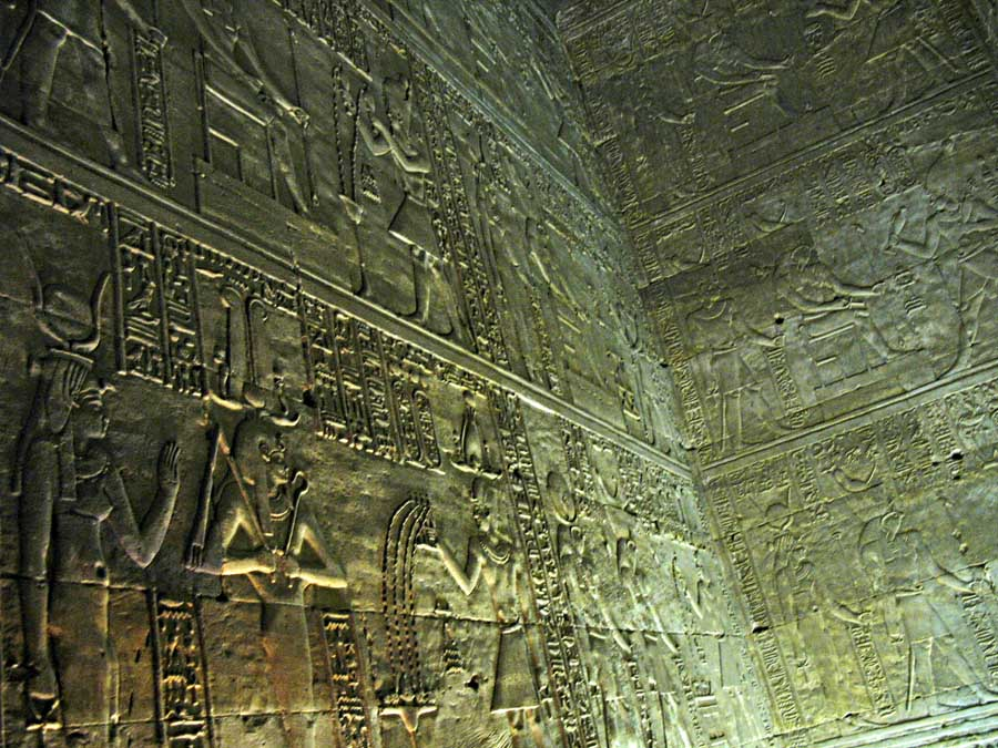 carved figures on Egyptian temple walls