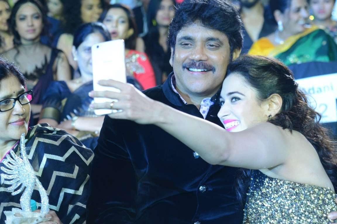 Tamannaah Bhatia poses for a selfie with Nagarjuna during IIFA Utsavam