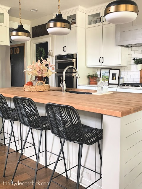 Gray island black chairs butcher block