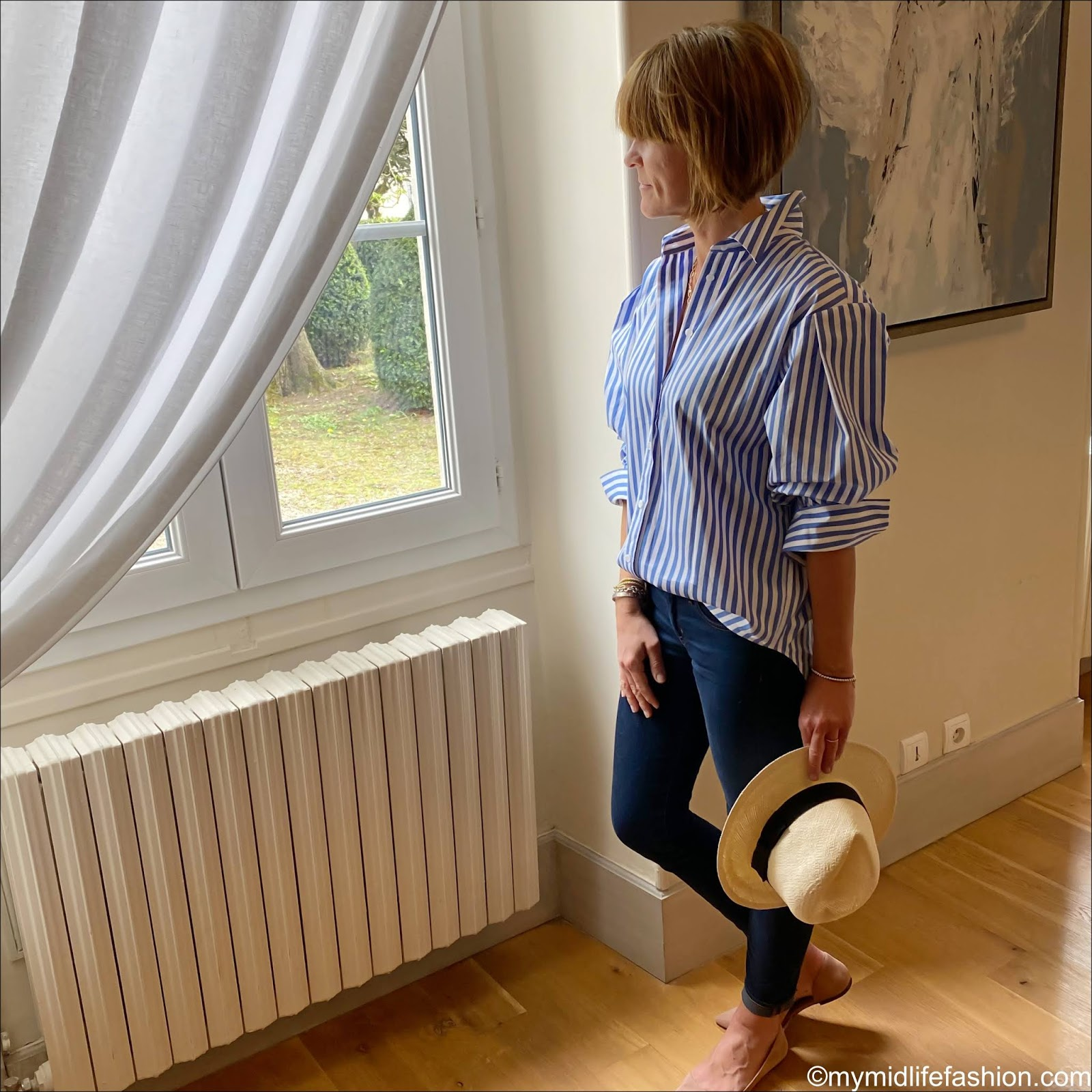 my midlife fashion, H&M Panama hat, and other stories stripe oversized shirt, j crew 8 inch toothpick jeans in true denim, H&M nude pink ballet flats, daisy London ester Lalonde luna lock necklace
