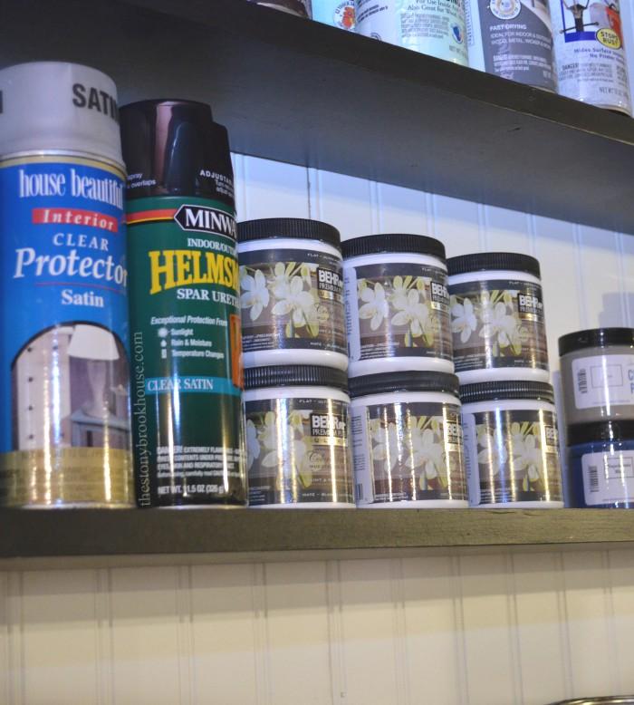 Paint organized on shelf