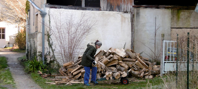 Moving firewood.  Indre et Loire, France. Photographed by Susan Walter. Tour the Loire Valley with a classic car and a private guide.