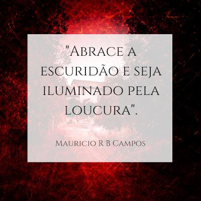 Frase sob fundo vermelho: Abrace a escuridão e seja iluminado pela loucura