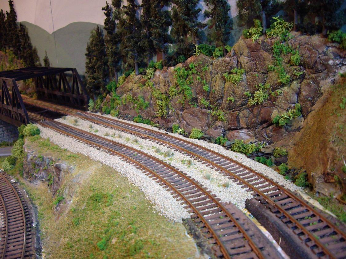 Light vegetation being applied on ballast between double tracks