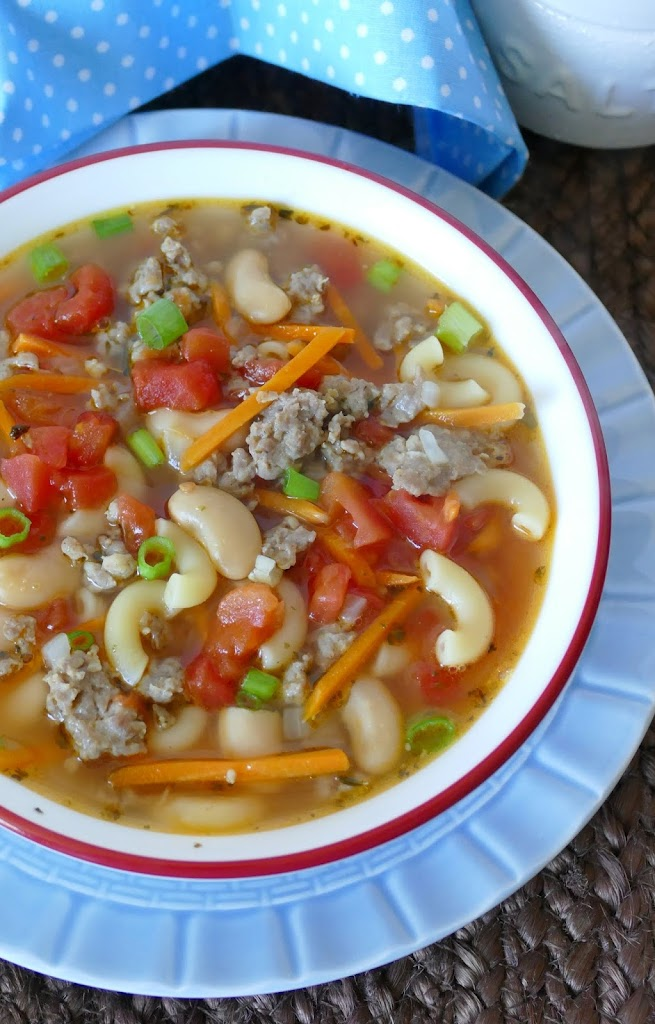 This hearty and delicious soup is budget friendly, freezer friendly and a crowd pleaser! Combine macaroni pasta, diced tomatoes, canned beans, and shredded carrots with ground pork for a great lunch or dinner!