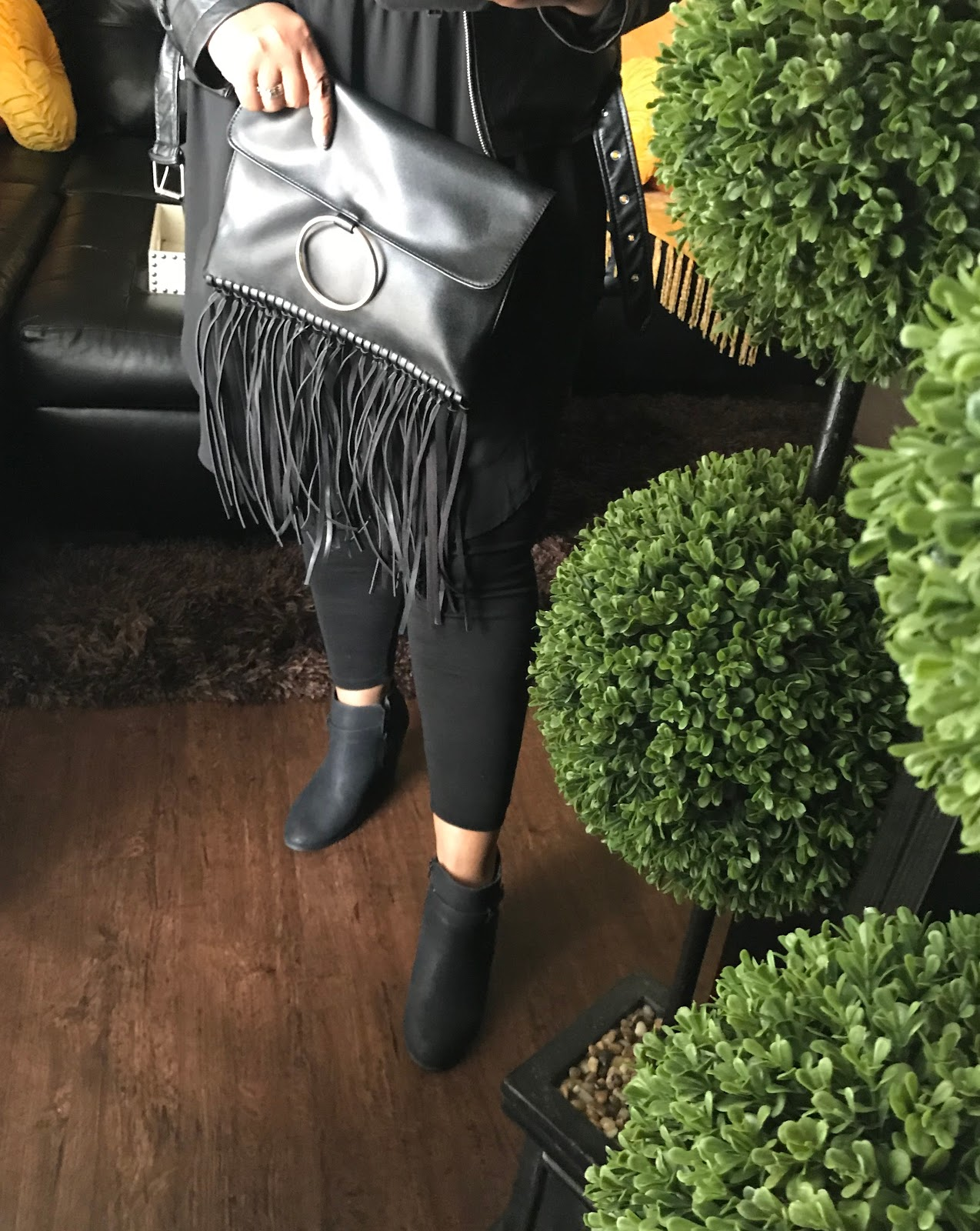 Tangie Bell sharing her outfit, leggings, fringe handbag, and black boots before DIY sale shopping and making jewelry