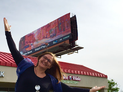 Photo of Robie with Billboard
