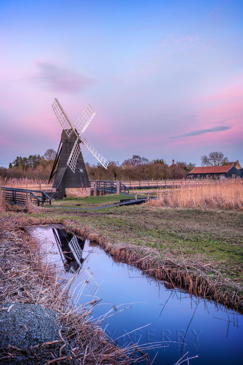 Dusk over the windmill at Wicken Fen Nature Reserve