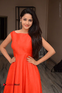 Telugu Actress Divya Nandini Stills in Orange Sleeveless Gown at Chennai Chaitrama Movie le Launch Event  0037.JPG