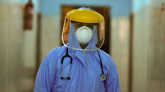 "A file photo of an Egyptian doctor in PPE ""AFP"""