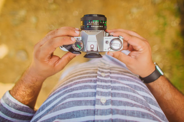 Top view shot of a pair of hands holding a camera.