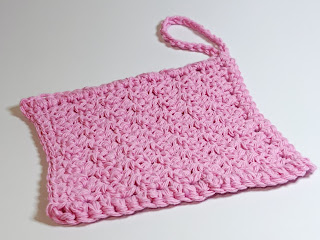 Pink square cotton crochet dishcloth with loop on white background