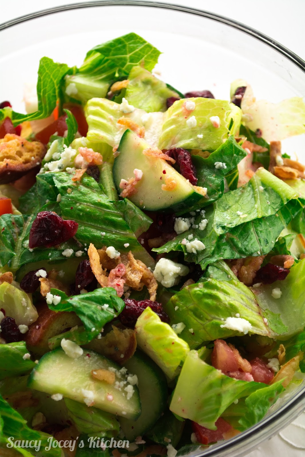 Sweet raspberry dressing, tangy blue cheese, tart dried cranberries, and salty french fried onions create the perfect flavor combination in this easy and versatile salad!